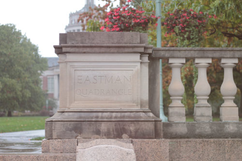 A stone ledge that surrounds Eastman Quadrangle at the University of Rochester.
