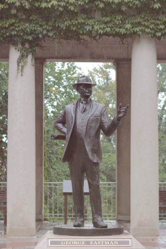 A statue of George Eastman in the Eastman Quadrangle at the University of Rochester.